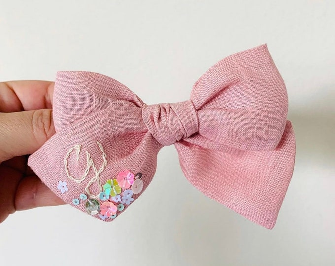 Featured listing image: Personalized Baby Bow, embroidered letter, Pale pink linen, nylon headband or alligator clip, custom monogram