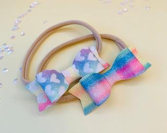 Rainbow Baby Bows, Rainbow sparkly Bows, Set of 2, Nylon Headbands or hair clips, Size 3 inches