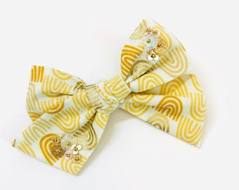 Baby Girl bow, The Golden Rainbow, Mustard and gold Rainbow print, embroidered sequins, nylon headband or alligator clip