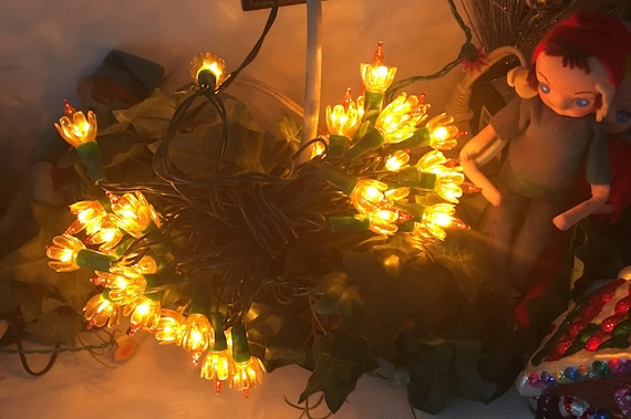 vintage amber colored string lights with tulip reflectors