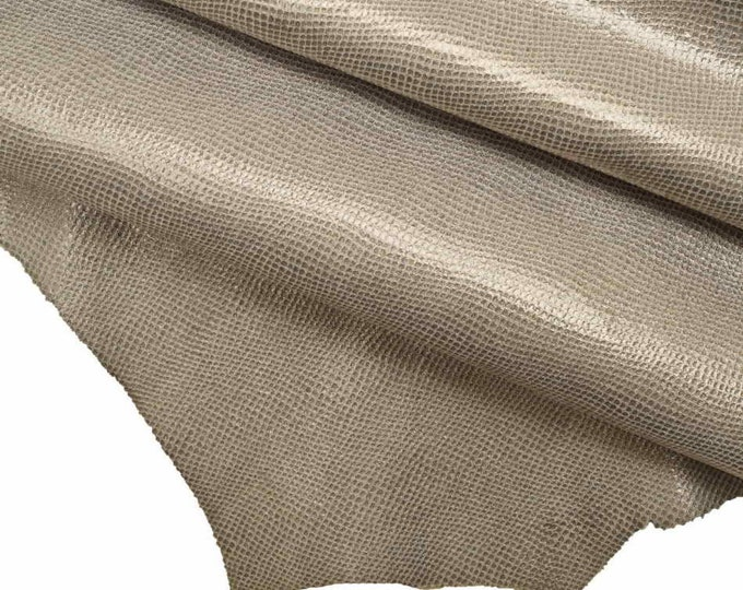 Italian leather quite soft skin   A7307-MT  La Garzarara suede hides with a snake print and bicolor foil size approx 20 x 25 inches