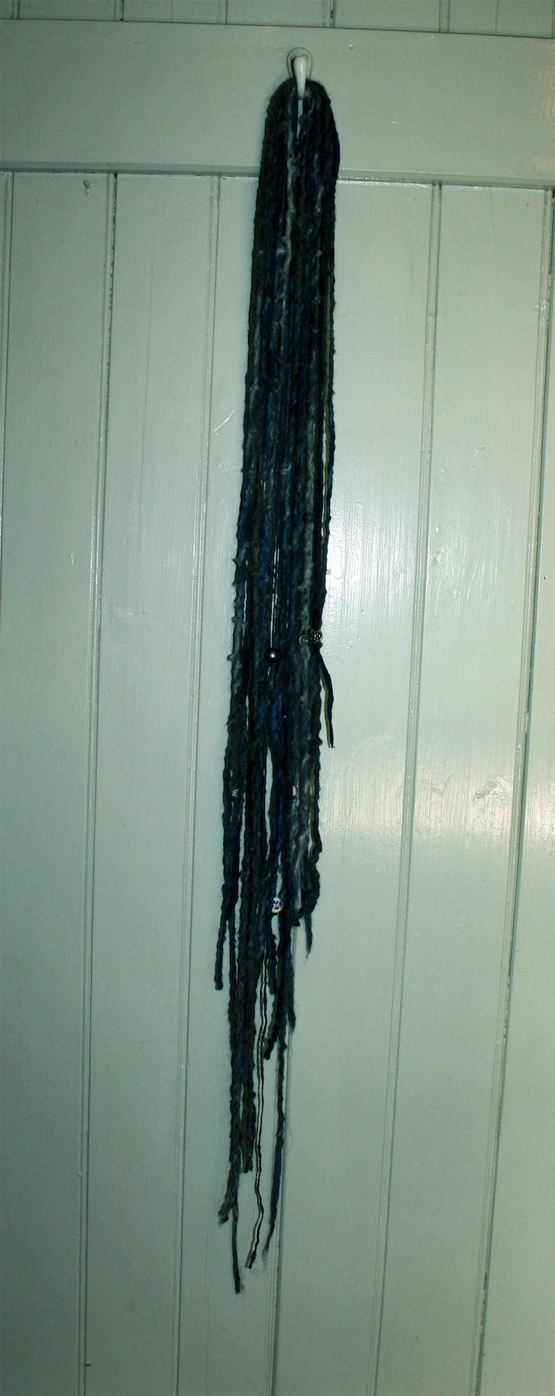 Dreadlocks with beads of hand-spun single yarn matted Blue Magic