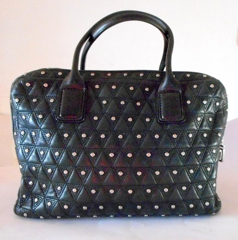 34cb299c23 Gianni Versace Vanitas Medusa Head Silver Studded Bondage Bag.