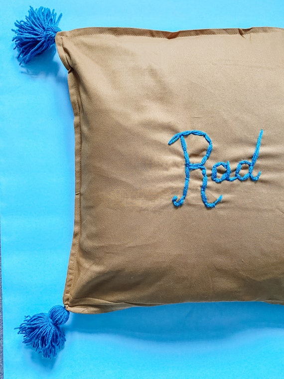 Personalised cushion cover in mustard yellow with tassels