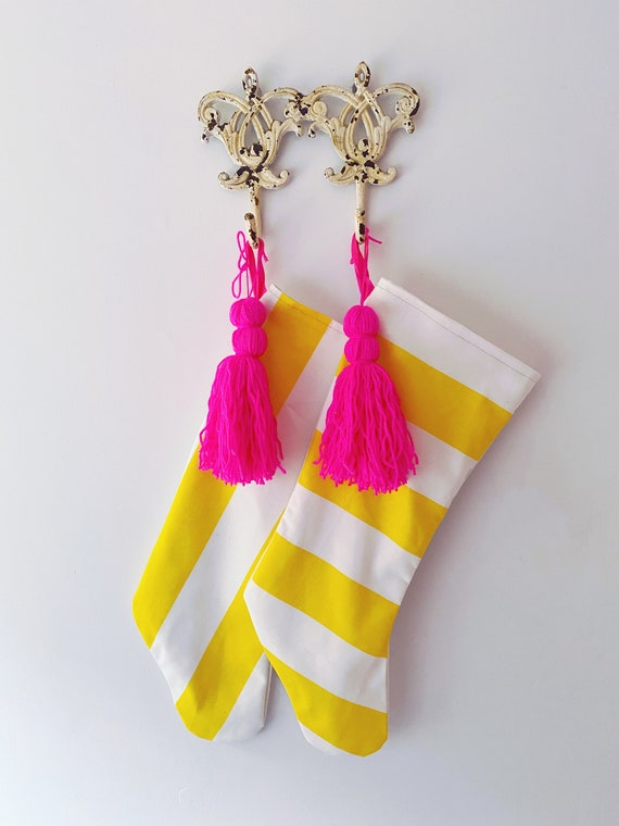 Yellow white stripe Christmas stocking with pink tassel
