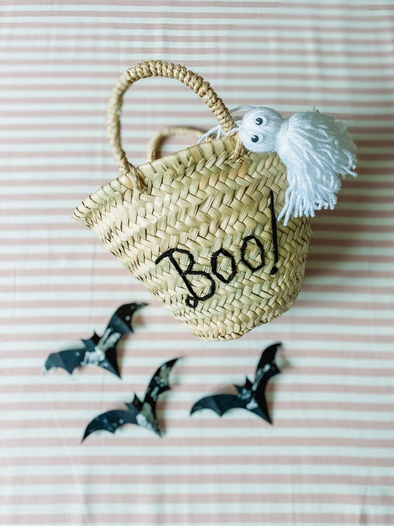 Personalised children's Halloween trick or treat basket with straw handles and tassel