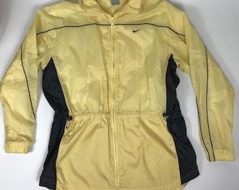 c7d29653ded0 Nike Vtg 90s Yellow Womens Windbreaker Rain Jacket Size Medium