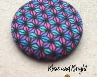 Geometric fabric covered button badge
