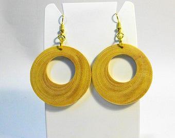 Earrings in solid carob-wood, natural color,round shape with holes.Orecchini legno di carrubo (Sicily)giovani rami,a cerchio forati,naturali