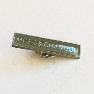 Hirondel Porte Clef M\u00e9daillon avec capsule de champagne Veuve Clicquot