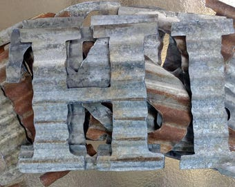 Small to Extra Large Corrugated Metal Letters.