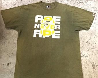 4d3965ec8 Bape x kaws tshirt   Etsy