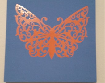 Butterfly on painted wood