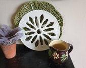 A pretty vintage ceramic pot stand trivet