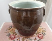 Gorgeously large antique French confit pot in dark brown with duck egg blue glazed interior.