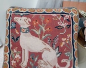 Vintage needlepoint cushion featuring a handsome lurcher surrounded by flowers with a pretty border, piped edge and navy blue backing.