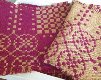 A set of six Welsh woven placemats in their original box.