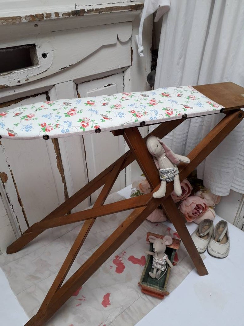 pretty vintage toy wooden ironing board with bird and floral cover and pink  gingham trim. toys/collectibles/display