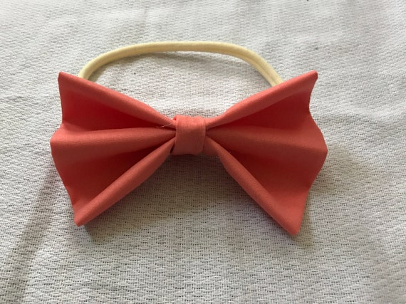 Coral big bow on a cream nylon band Babygirl toddler Girl 6728f3f07d9b