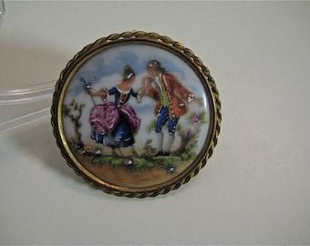 A porcelain brooch
