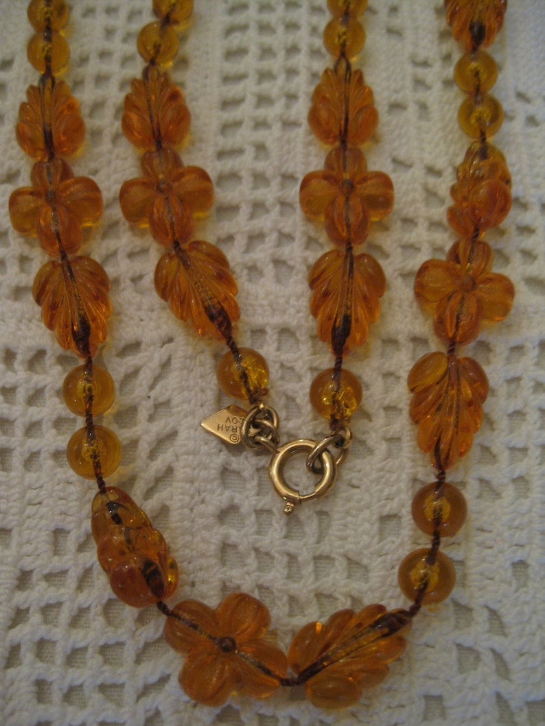 AMBER SARAH COVENTRY Necklaces Clear Amber Lucite Leaves Flower Round Beaded Necklace Gold Tone Clasp Tag Signed Sarah Coventy Vintage 1970s