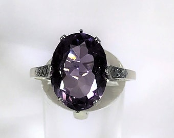 A Beautiful Sterling Silver Amethyst Colour Purple Stone ring.  UK Size S