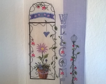 Hand stitched wall hanging saying welcome