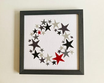 Framed hand stitched cross stitch picture, wreath of stars