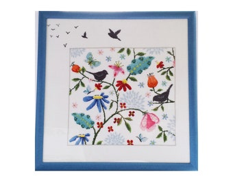 Hand stitched and framed cross stitch picture with birds and flowers