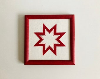 Hand stitched cross stitch picture, red Christmas star, framed cross stitch picture