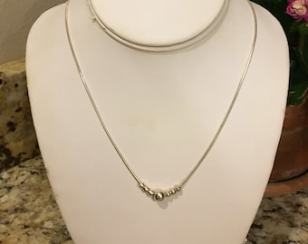 Sterling silver chain with floating silver beads