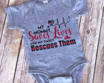 3745e1831 My mommy saves lives and my daddy rescues them Paramedic Baby tee, Nurse  firefighters