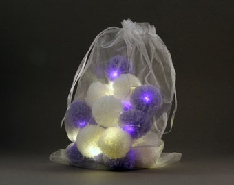 20 pom-pom LED fairy lights in white and lilac pom-poms.
