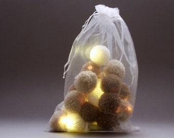 20 pom-pom LED fairy lights in chocolate , latte  and cream pom-poms.