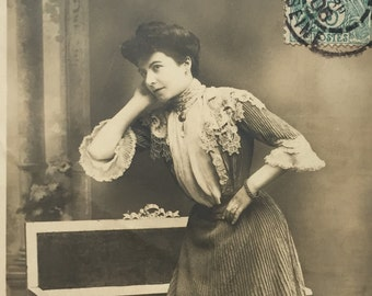 1900s vintage postcard of Victorian Photograph of French lady waiting and thinking