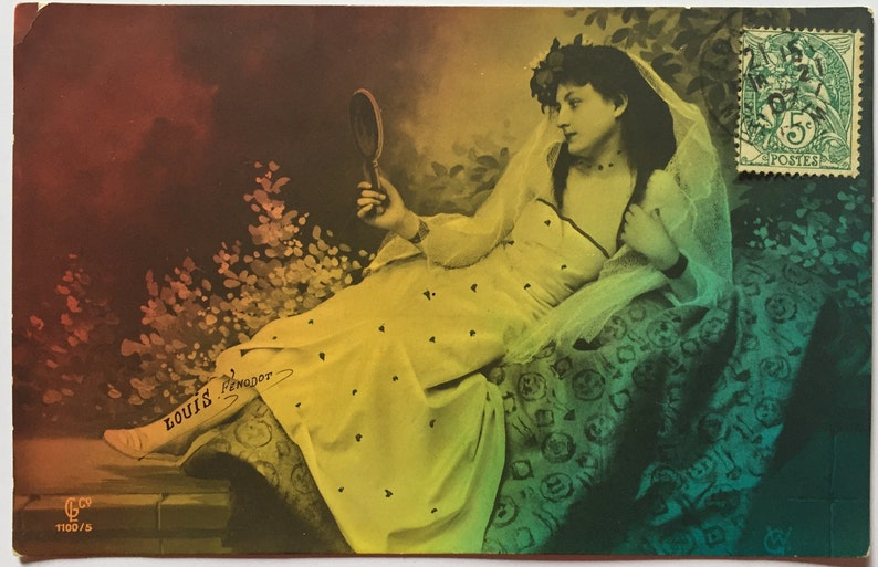Rainbow photograph of lady lying down Antique French postcard image 0
