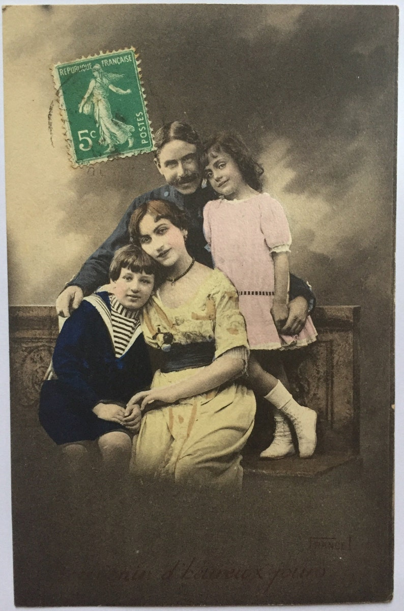 Vintage Photograph of a happy family of four 1900s French image 0