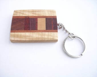 Curly maple and assorted exotic hardwood key chanin