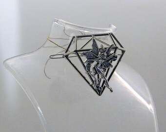 Barette where a nonchalant Fairy has taken up residence on a diamond structure
