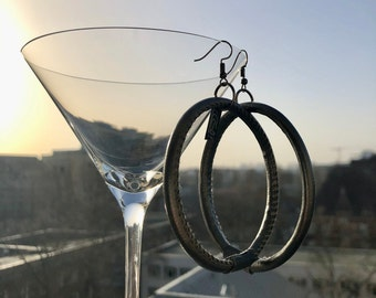 Large Metallic vegan earrings made of very light, flexible, dark grey material shimmering silver, open ear hook