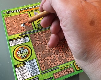 Lottery card scratching tool