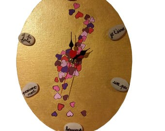 Clock handcrafted pebbles, pendulum, I love you, a little lot, passionately, madness, that's it!