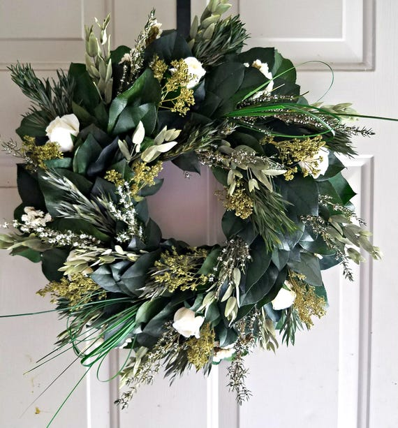 Preserved leaf wreath made with creams and other natural dried and preserved materials