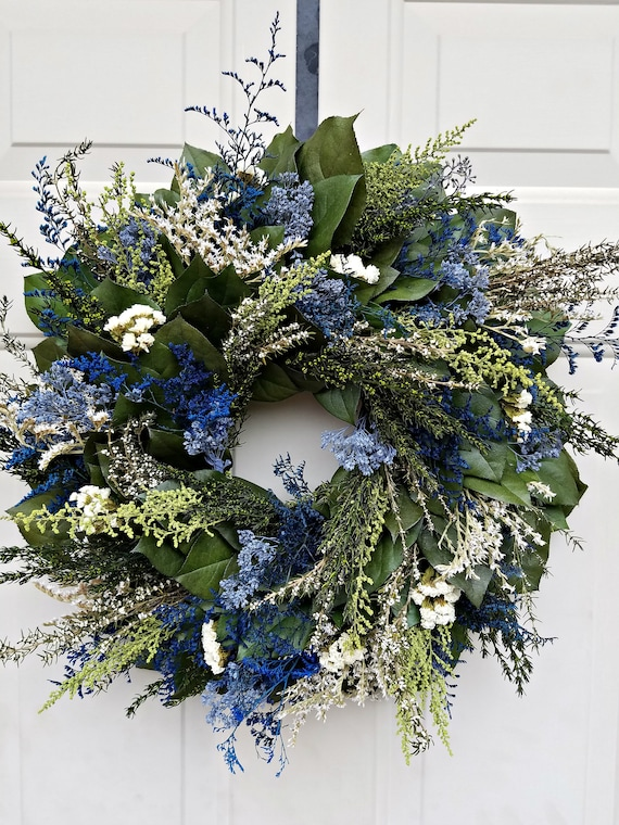 Blue wreath preserved with natural foliage and leaves measures 23 inches and makes a great gift for any holiday or special occasion