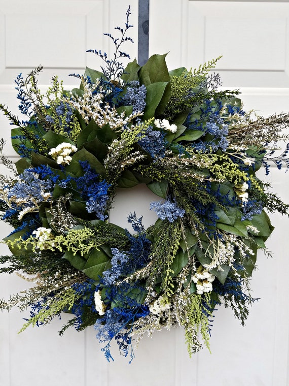 Blue wreath preserved with natural foliage and leaves measures 23 - 24 inches