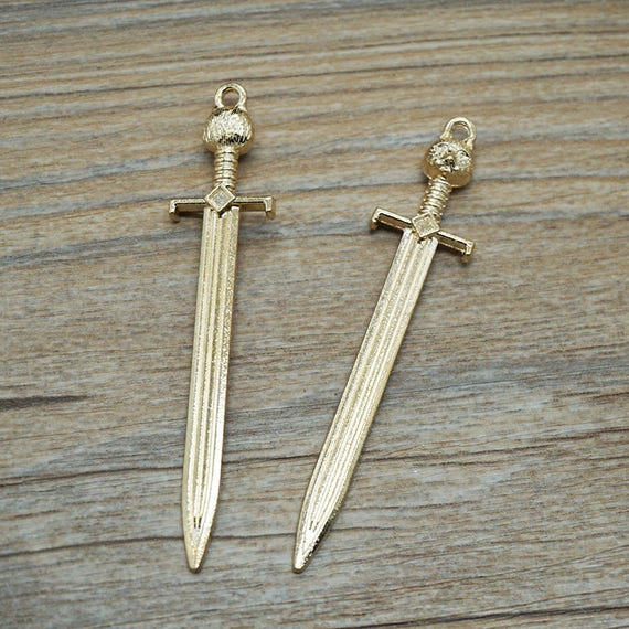 10pcs antique gold kitty sword pendants for necklace accessory diy 10pcs antique gold kitty sword pendants for necklace accessory diy 67 mm x 14 mm 507 67 from easonsupply on etsy studio mozeypictures Choice Image