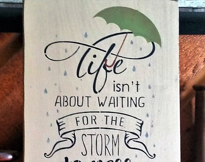 "Primitive ""Life Isn't About Waiting For The Storm To Pass"" Sign"