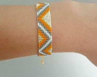 Orange, silver and white triangle bracelet