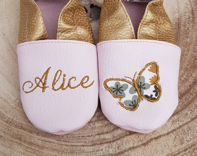A pair of custom Alice soft slippers and limited edition applied butterfly