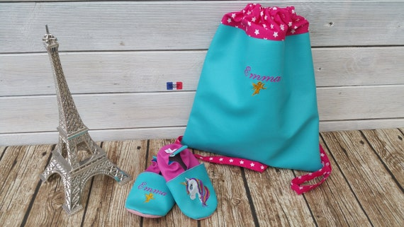 Set consisting of a mother's backpack and a pair of soft slippers